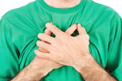 Hands on breast because of hard breathing