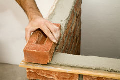 Hands of bricklayer by the work Stock Image