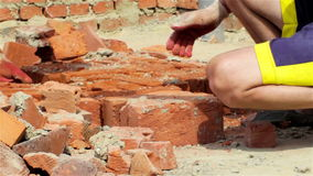 Hands are bricks in construction stock video footage