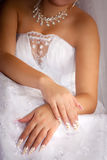 Hands of the bride Stock Photos