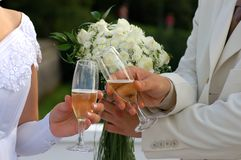 Hands of bride. And fiance with champagne glasses Royalty Free Stock Image