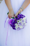 Hands of the bride with a bouquet Royalty Free Stock Photos