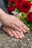 Hands of bride and bridegroom Stock Images