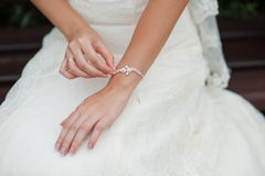 Hands of a bride with a decoration bracelet Royalty Free Stock Photo
