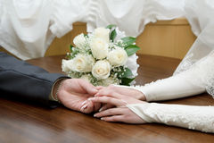 Hands of the bride and groom Stock Photography
