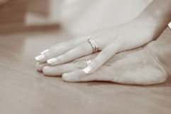 Hands of bride and groom. Bride and groom hands-sepia royalty free stock photography