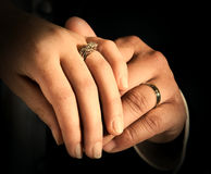 Hands of bride and groom. Together with wedding rings Stock Photos