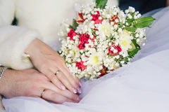 Hands of Bride and Groom. Hands of the groom and the bride and bouquet stock photography