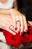 Hands of a bride Stock Image