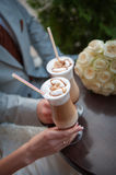 Hands of bride and groom. Cappuccino or latte coffee with heart Stock Images
