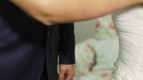 Hands of bride and groom stock video