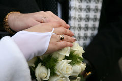 Hands of bride and groom near wedding bouquet Royalty Free Stock Photos