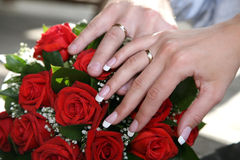 Hands of bride and groom near wedding bouquet Royalty Free Stock Photo