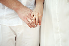 Hands of bride and groom. With rings Royalty Free Stock Photography