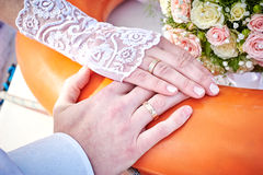 Hands of the bride and groom with rings on a beautiful wedding Stock Photography