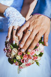 Hands of bride and groom with rings on wedding Stock Images
