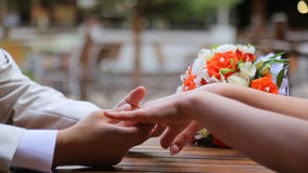 Hands of bride and groom stock footage