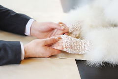 Hands of bride and groom on their wedding day, love Stock Image