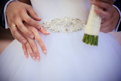 Hands of the bride and groom at the waist Stock Photo