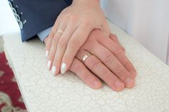 Hands of bride and groom with wedding rings. royalty free stock images