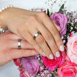 Hands of a bride and groom with wedding rings Royalty Free Stock Photo