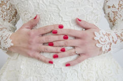 Hands of a bride Stock Photography