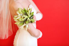 Hands of bride hold bouquet Royalty Free Stock Photography