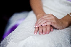 Hands of a bride. Bride's hands are on his knees royalty free stock images