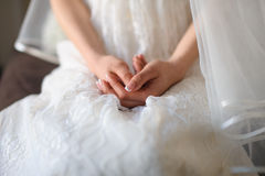 Hands bride stacked together. Bride hand on white dress,ready for marriage ceremony Royalty Free Stock Photos