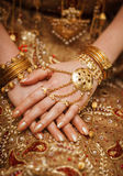Hands of a bride in a traditional wedding jewelry. Sri Lanka Royalty Free Stock Photo