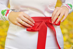 Hands of the bride in the Ukrainian style Stock Photo