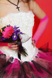 Hands of bride wearing in dress hold bouquet royalty free stock image