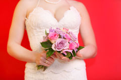 Hands of bride wearing dress hold bouquet Royalty Free Stock Photos