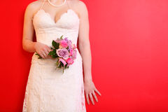 Hands of bride wearing dress hold bouquet Stock Photo