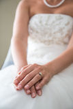 Hands of the bride Stock Images