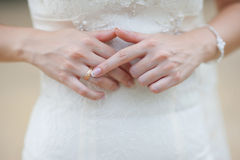 Hands of a bride at a wedding. pointing to the golden ring Royalty Free Stock Photography