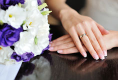 Hands of a bride with a wedding ring Stock Photography
