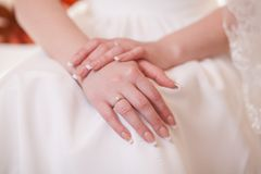 Hands of a bride Stock Photo