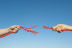 Hands broken rope sky background Royalty Free Stock Photography