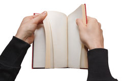Hands browsing a book Royalty Free Stock Photography