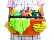 Hands with bucket of cleaning products. stock images