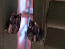 Hands of Buddha Door Handles Stock Photos