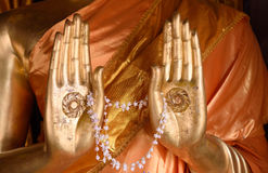 Hands of Buddha stock photos