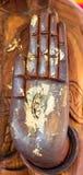 Hands of Buddha statue Stock Photos