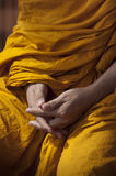 Hands of Buddhist Monk. During Meditation Stock Photography