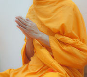 Hands of Buddhist monk Stock Photo