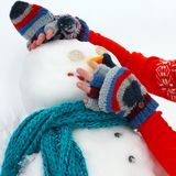 Hands Building Snowman Outside in Winter royalty free stock photography