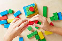 Hands building tower with building blocks Stock Images