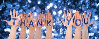 Hands Building Word Thank You, Glittering And Sparkling Bokeh Background. Many Hands Building English Word Thank You. Glittering, Sparkling And Magic Bokeh And stock images