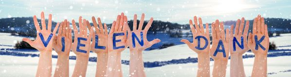 Hands Building Word Vielen Dank Means Thank You, Winter Scenery. Many Hands Building German Word Vielen Dank Means Thank You. Beautiful Snowy Winter Landscape royalty free stock photos